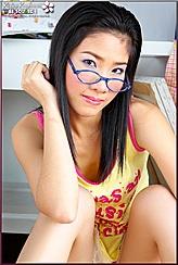 Leaning Forward Glasses On Bridge Of Her Nose Knees Raised