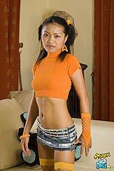 Standing In Orange Top Wearing Skirt