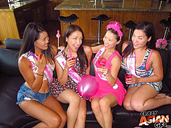 Four Girls At Bachelorette Party Sitting On Couch