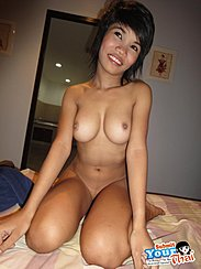 Kneeling Nude On Bed Squeezing Her Firm Breasts Together