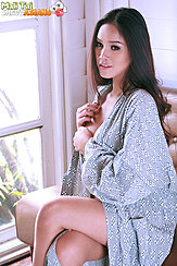 Seated With Legs Crossed In Robe Long Hair