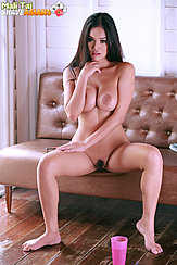 Sitting Nude On Couch Big Breasts Squeezed Together Legs Spread Trimmed Pussy Hair Bare Feet