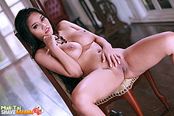 Leaning Back Naked On Chair Big Breasts Legs Spread Hand On Her Shaved Pussy
