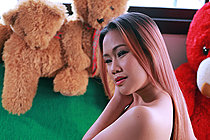 Pretty Nam Patarada Strips On Sofa And Bares Her Shaved Pussy