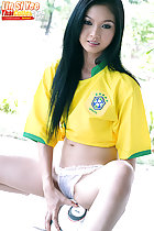 Lin Si Yee seated on football legs open in panties long hair over her brazil shirt