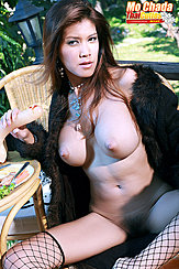 Seated In Long Coat Long Hair Touching Her Big Tits Holding Dildo Legs Open Wearing Fishnets