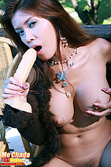 Holding Dildo To Her Open Mouth Fondling Her Big Breasts