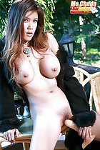 Big tits long haired Mo Chada with her legs spread holding dildo to her pussy