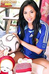 Sitting Cross Legged Holding Ball Wearing Japan Football Shirt