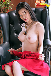 Seated Topless Necklace Dangling Between Her Big Tits Long Hair