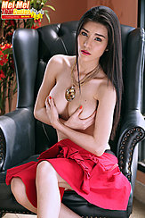 Seated Topless Cupping Her Big Breasts Long Hair