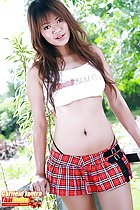 Long hair falling over her crop top wearing plaid short skirt