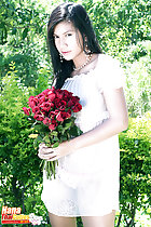 Wearing transparent dress holding bunch of roses
