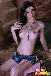 Sitting Topless On Hai Bale Necklace Between Her Tits Wearing Denim Shorts
