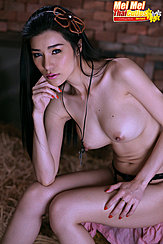 Mei Mei Seated Topless Big Tits Hand On Thigh Wearing Topless