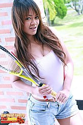 Holding Tennis Racquet Long Hair Over Her White Top Wearing Denim Shorts