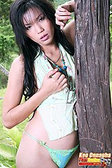 Kee Onnapha Standing Against Tree Wearing Panties