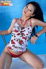 Kneeling Beside Pool Wearing White Top In Red Panties