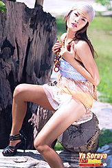 Seated On Tree Stump Wearing Bandana In High Heels