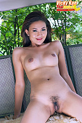 Seated Nude Leaning Back Legs Open Showing Her Pussy