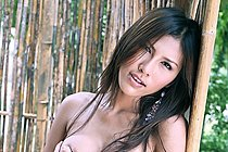 Breasty Beauty Chelsea Strips In Front Of Bamboo Screen