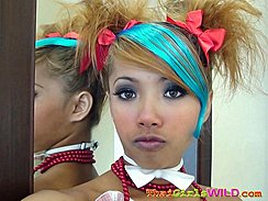 Hair Up In Ribbons Lips Pursed Wearing White Bow Tie