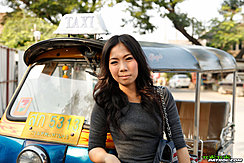 Standing Beside Tuk Tuk Handbag Over Her Shoulder Long Hair